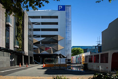 Living Wall and Art Work (Jocey K) Tags: newzealand nikond750 christchurch building architecture rebuild puddle reflection artwork livingwall signs roadcones trees shadows sky cbd