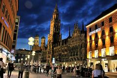 Munich at Night (Jill Rowland) Tags: munich night city lights architecture sky blue steeple sidewalk people