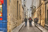 hiking (albyn.davis) Tags: paris france europe people street walking travel vacation color blue bookstore light buildings alley