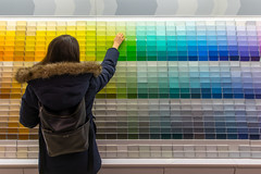 Touch the Rainbow (cookedphotos) Tags: 2018inpictures toronto ontario canada ca canon 5dmarkiv streetphotography canadiantire paint swatches chips rainbow color colour girl woman reach touch 365project p3652018