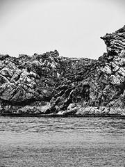Shore rocks (markb120) Tags: andaman similan island islands thailand sea ocean isle insula jackal rock crag scaur scar stone calculus scale concretion gum coast shore littoral water sky heaven palate blue roofofthemouth sphere cloud eddy bw