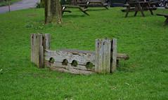 A set of stocks (Blue sky and countryside) Tags: setofstocks litton village peak district derbyshire medievalpunishment barbaric england humiliating pentax villagegreen