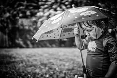Under the Brolly (miniwaites) Tags: nex bokeh brolly mono sony wet nik child monochrome bw mood umbrella moody tree a6000 blackandwhite sprinkler niksuite rendlesham england unitedkingdom gb