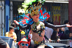 Carnaval Parade SF 168 (TheseusPhoto) Tags: carnaval carnavalsf sanfrancisco bayarea missiondistrict parade costume people candid streetphotography streetportrait street carnaval2018 girl woman pretty smile pose por feathers colors colorsoftheworld