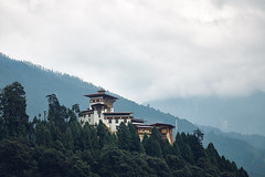 Bhutan: Gasa Dzong. (icarium.imagery) Tags: bhutan canoneos5dmarkiv architecture buddhist canonef85mmf12lii captureone coniferoustrees drukyul dramaticsky forest fortress gasavalley green hills himalayas layers leefilters moody monastery mountains mystical mysterious naturallight nature rural gasadzong cloudy