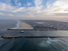 A DJI Phantom 4 drone hovers over the Atlantic Ocean, capturing a  fishing boat in the Manasquan Inlet returning to port. (apardavila) Tags: atlanticocean djiphantom4 jerseyshore manasquan manasquanbeach manasquaninlet pointpleasantbeach aerial clouds drone fishingboat sky
