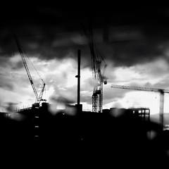 City (Darryl Scot-Walker) Tags: blackandwhite moody clouds atmospheric skyline construction cranes londonstreets londonstreetphotographers londonarchitecture architecture sky monochrome urban urbanlandscape