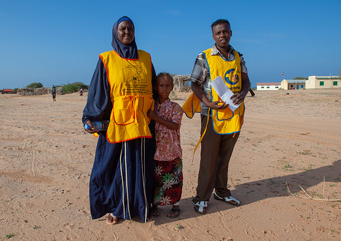 A woman and a man in a campaign for polio vaccination, Awdal region, Lughaya, Somaliland
