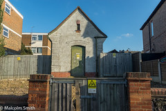The Electrical Sub-Station (M C Smith) Tags: electric pentax k3 door building electrical substation blue clouds white buildings flats fencing wooden symbols signs yellow wall house trees green aerials dishes gates red car parked lamps black gravel slope