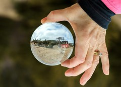 In a Happy Place (Karen_Chappell) Tags: ball round glass orb sphere refraction red hand people newfoundland nfld circle torscove cribbies house cabin cottage canada atlanticcanada avalonpeninsula tree bokeh