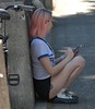 Back Against The Wall (Scott 97006) Tags: woman female lady seated profile hairdye phone