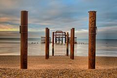 HDR West Pier (Geoff Henson) Tags: hdr beach seaside sea ocean pier ruins derelict pillars posts shingle clouds sky morning daybreak dawn seascape dream blue 1000v40f