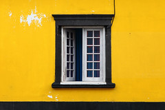 Yellow, yellow (Elios.k) Tags: horizontal outdoors nopeople building exterior house yellow brightcolour window openwindow casementwindow wall architecture design urban colour color frame blackstone chippingpaint ilheverde travel travelling june2017 summer vacation canon 5dmkii photography island saomiguel acores pontadelgada azores portugal europe
