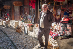 The Bazaar, Kruje (judepics) Tags: shopkeeper albania bazaar cobbles kruje ll man shop portrait