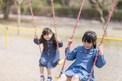 Little sisters playing on swing (Apricot Cafe) Tags: img86443 asia asianandindianethnicities canonef85mmf14lisusm healthylifestyle japan japaneseethnicity adolescence candid carefree casualclothing charming cheerful chibaprefecture child childhood colorimage day elementarystudent enjoyment girls happiness innocence leisureactivity lifestyles longhair nature outdoors people photography playequipment playing preschoolage publicpark realpeople schoolchildren sister smiling springtime straighthair sustainablelifestyle swing swinging toddler togerherness toothysmile twopeople weekendactivities ichiharashi chibaken jp
