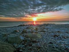Beach Sunset (Ian Gedge) Tags: uk britain wales northwales dinasdinlle sea seaside beach stones rocks pebbles shore sunset cymru sky