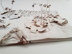 how to leave a story (Ines Seidel) Tags: book alteredbook writing leaving wire white text handwriting ink buch buchkunst pattern texture paper bookart
