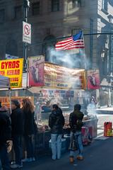 Old Glory in the smoke (jeremyhughes) Tags: newyork street market stall marketstall smoke smoky oldglory starsandstripes usa madisonavenue winter food foodstall cold weather winterlight nikon d700 nikkor 50mm 50mmf14d starsandbars kebabs