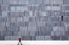 Grey Wall (CoolMcFlash) Tags: negativespace copyspace person walking facade structure background street streetphotography vienna mq museumsquartier mumok canon eos 60d motion blur gehen fassade struktur hintergrund strase wien bewegung bewegungsunschärfe fotografie photography city stadt citylife sigma 1020mm 35 candid