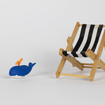 Beach chair with small whale toy thumbnail