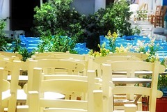 Waiting for the crowds (jimiliop) Tags: chairs bars restaurants street empty island kimolos white blue afternoon hardlight flowers greece