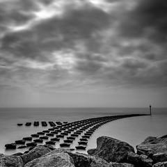 Felixstowe (Merrik76) Tags: felixstowe suffolkcoast suffolk seascape sea seadefence longexposure hightide clouds neutraldensity april calm rocks texture bw blackwhite mono
