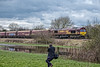 Jim springs into (the) action (Peter Leigh50) Tags: ews train freight railway railroad water reflection people