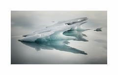 Evanescence (Lindi m) Tags: iceland iceberg lagoon fjallsárlón shard reflections blueice melting cold serene calm still sculptured
