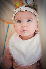 A mouthful of porridge (tuvaloland) Tags: toddler child baby babygirl childhood girl kid eyes innocence cute beautiful playful happy family portrait