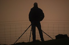 Five legs in the sunset. (cymrost) Tags: wales sunset tripod person photographer orme