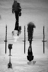 Two bystanders during a rainy day (jeffclouet) Tags: paris france europe capital nikon nikkor d7100 city ville cuidad street calle rue monochrome blackandwhite bw pb nb urbain urbano urban downtown pluie raining rain lluvia paragua parapluie umbrella people personas personnes reflection reflejo reflet reflexion ombre sombras shadows silhouette siluetas beaugrenelle streetshot streetphotography streetpic walking walker bystanders