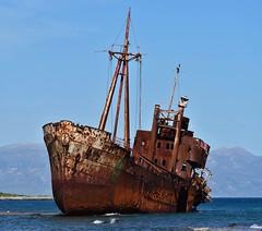 Agios Demetrios by Gytheio (orientalizing) Tags: 23dec1981 agiosdimitrios coast eroding greece grounded gytheio gytheion laconia peloponnese shipwreck shore valtakibeach panorama rust