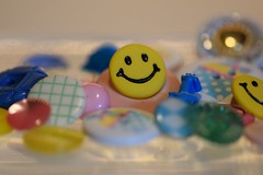 Happy Plastic (ladybugdiscovery) Tags: plastic buttons yellow blue green pink macro dof