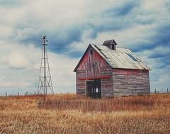 fading glory....(HWW) (BillsExplorations) Tags: windmillwednesday windmill oldfashioned vintage old barn crib farm field grass sky clouds fence hww