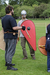Historia Normannis Meadows June 2018-43 (Philip Gillespie) Tags: historia normannis central scotland sparring fighting shields swords axes spears park grass canon 5dsr men man women woman kids boys girls arms feet hands faces heads legs shins running outdoor tabards chain mail chainmail helmets hats glasses sun clouds sky teams solo dead act acting colour color blue green red yellow orange white black hair practice open tutorial defending attacking volunteer amateur kneeling fallen down jumping pretty athletic activity hit punch
