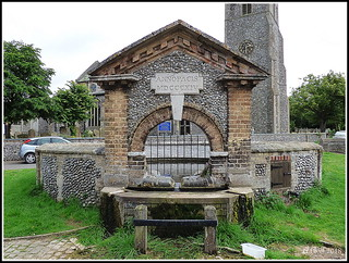 The well drinking trough water fountain reservoir spring which stands in the middle of Upper Sheringham