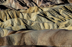 Death Valley - Zabriskie Patterns - 20888 (www.karltonhuberphotography.com) Tags: 2014 abstract adventure amazing beautiful california claystone color colors deathvalley deathvalleynationalpark details exploring formations geologichistory geologicwonder geology horizontal inspiring intriguing karltonhuber landscape landscapephotography light lines morninglight nationalpark naturalworld nature nikkor70200vrii nikond7000 outdoors patterns peaceful rocks rolling siltstone texture wavy wildplaces wilderness wonder