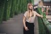 Portrait (Vagelis Pikoulas) Tags: photography photoshoot bokeh portrait woman women girl canon 6d tamron 70200mm vc blur september autumn 2017 hungary budapest europe bridge green