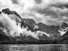 milford sound kayak (AlistairKiwi) Tags: nz newzealand mountain travel landscape olympus omd blackandwhite monochrome sky rock photo sound fiordland milford rain water sea kayak