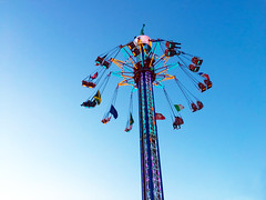 5554_1024 (saragallery) Tags: fairground rollercoaster color light lights colorist architecture perspective fly people photojournalism fun happy amusement party children exciting dizzy sky
