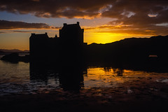 Scotland: Eilean Donan Castle at Sunset (rocinante11) Tags: scotland silhouette unitedkingdom eileandonancastle film filmcamera slidefilm