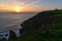 The edge of the world (trojanhorse1956) Tags: sunset lundy atlantis sea cliffs thrift lighthouse sky clouds grass nikon d750 landscape