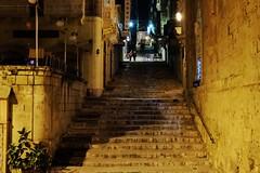 St Ursula Street (Douguerreotype) Tags: people dark malta buildings street lights architecture city stairs valletta night urban steps