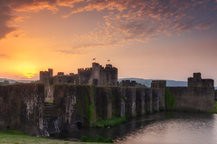 Sunset at Caerphilly Castle (Rich Walker75) Tags: caerphilly caerphillycastle castle castles wales moat sunset cloud sky landscape landscapes landscapephotography landmark landmarks canon efs1585mmisusm eos eos80d historic history