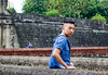 noel (Blitzkreig Padz) Tags: photography denim river water street seaside adobe lightroom canon portrait man boy stones culture manila intramuros red blue