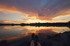 Kick Up Your Feet... (Tiara Rae Photography) Tags: shoes feet sunset sky rocks reflection lakes relaxing holiday weekend memorial day vacation summer break nebraska omaha nature landscape zorinsky lake clouds orange