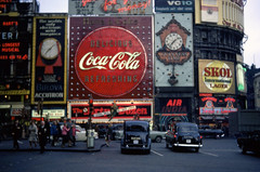 london (foundin_a_attic) Tags: london picadilly circus 1969 neon adverts advertisment cocacola boac bulova guinness