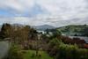 Calm Waters (Jocey K) Tags: newzealand nikond750 southisland akaora bankspeninsular landscape akaoraharbour hills trees houses morning clouds sea garden spring