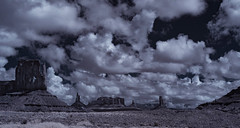 Monument Valley Monuments Under Clouds - Infrared (Bill Gracey 20 Million Views) Tags: monumentvalley arizona monuments infrared ir convertedinfraredcamera clouds monsoonalclouds sky vegetation vacation