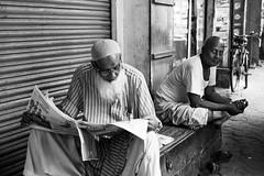 Preoccupied With the News (anthonypond) Tags: 50mmsummilux kolkata bw leicam10 calcutta india